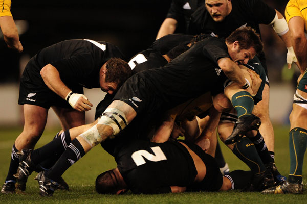 Richie McCaw makes a tackle during Saturday's match against the All Blacks (Photosport)
