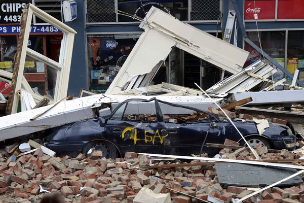 A car in central Christchurch is crushed under rubble (NZPA)