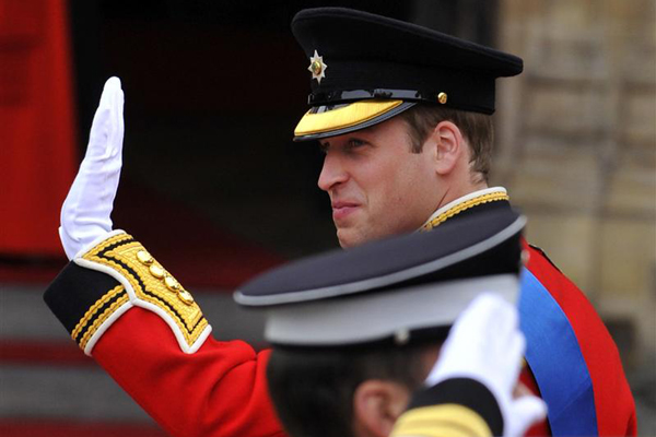 Britain's Prince William waves as he arrives at Westminster Abbey in central London (Reuters)