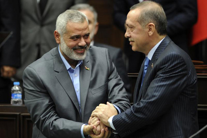 Turkey's Prime Minister Recep Tayyip Erdogan and Hamas' Gaza leader Ismail Haniyeh(Reuters)