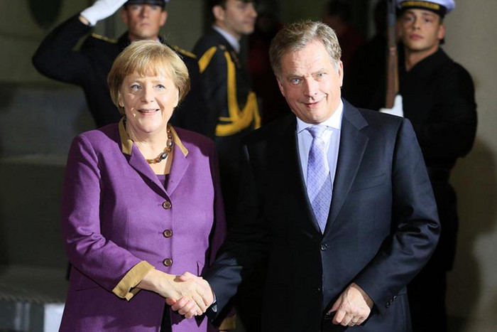 German chancellor Angela Merkel with Finnish president Sauli Niinisto  (Reuters)