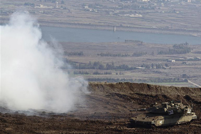 An Israeli tank manoeuvres close to the ceasefire line between Israel and Syria on the Israeli-occupied Golan Heights (Reuters)