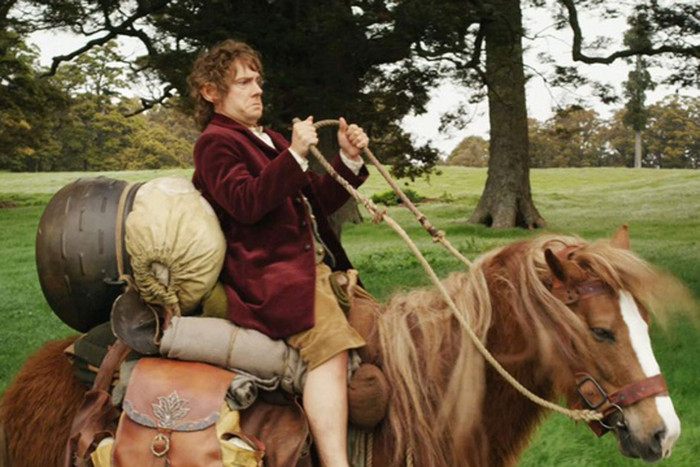 Bilbo Baggins rides a horse in a scene from The Hobbit