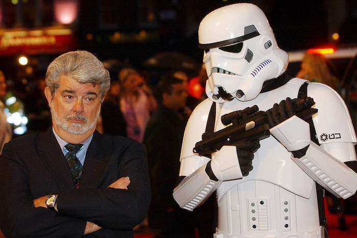 Star Wars creator George Lucas poses with a Storm Trooper in 2005 (AAP)