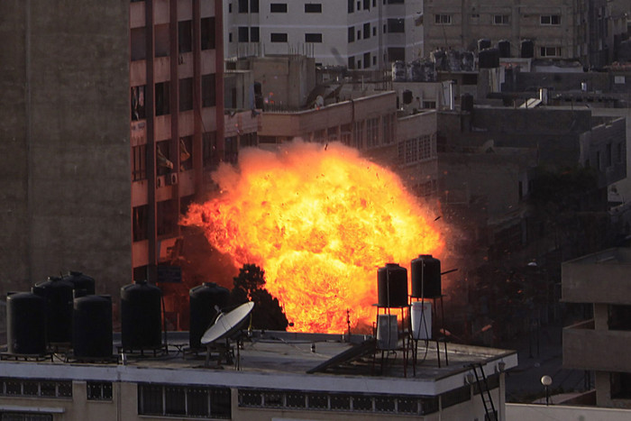 A fireball rises from the Al Shoroq building after an Israeli air strike in Gaza city, (AAP)