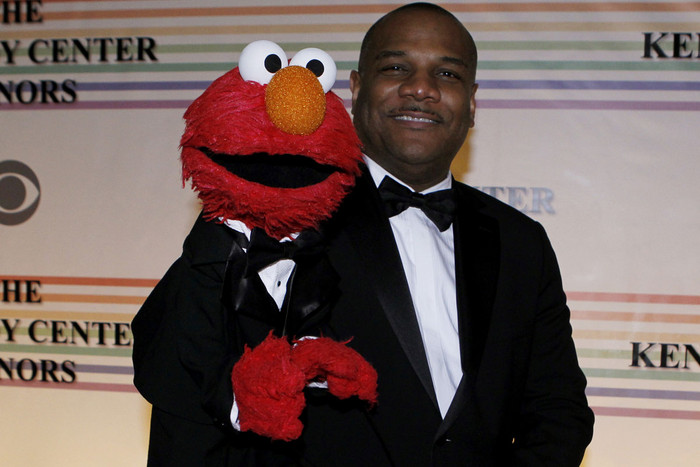 Elmo with his puppeteer, Kevin Clash (Reuters)