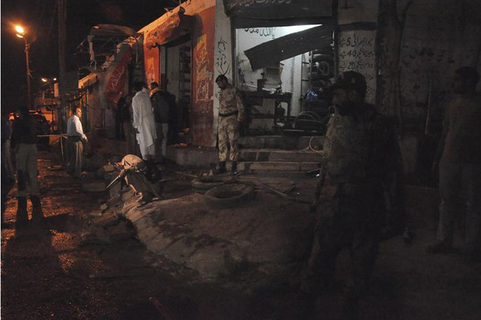 Soldiers inspect the site of a bomb blast in Karachi (Reuters)