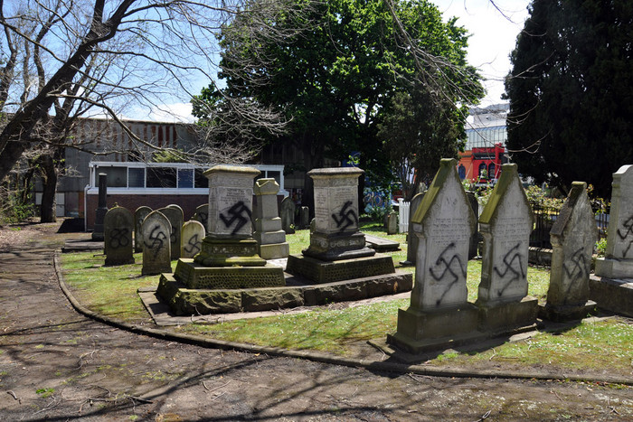Jewish graves which were vandalised with neo-Nazi symbols at Symonds St Jewish Cemetery in central Auckland (AAP)