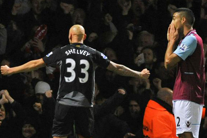 Liverpool's Jonjo Shelvey celebrates whilst Winston Reid despairs (Reuters)