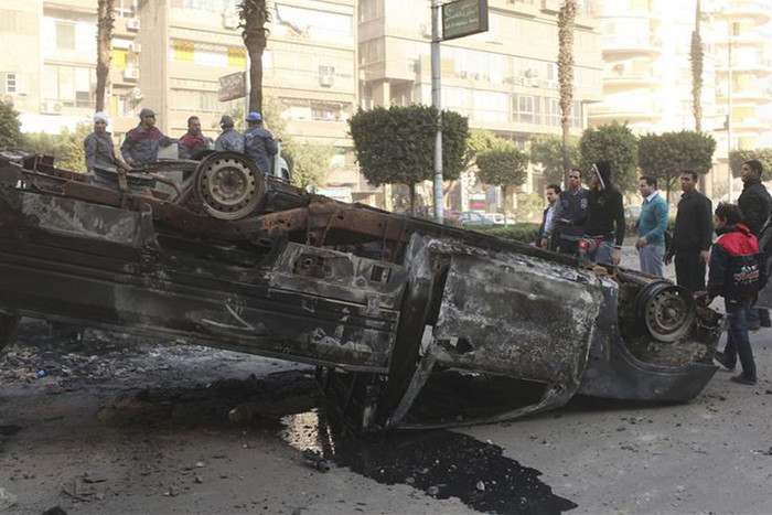 A burnt police car, which was damaged during clashes (Reuters)