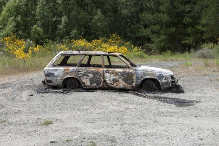The burnt out car