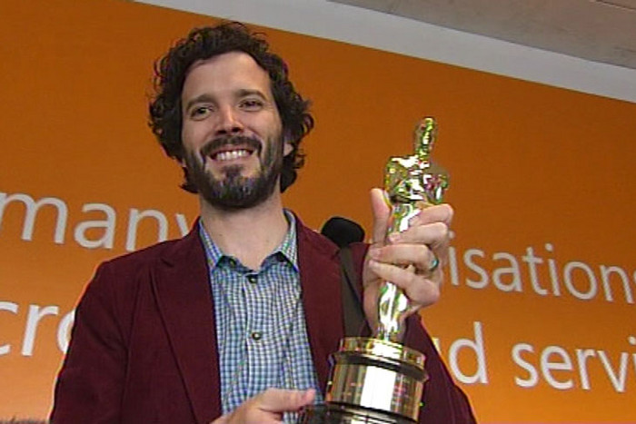 Bret McKenzie holding his Academy Award (3 News)