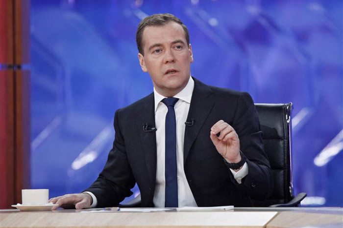 Russia's Prime Minister Dmitry Medvedev speaks during his interview with national television channels in Moscow (Reuters)