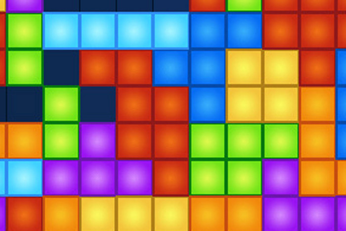 Tetris is a popular tile matching puzzle video game in which falling box shapes must be manipulated to create horizontal lines of blocks