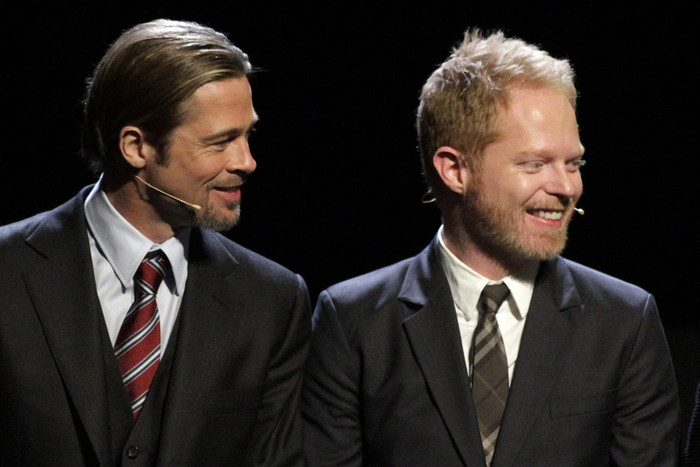 Brad Pitt and Jesse Tyler Ferguson stand onstage during the curtain call at the one-night production of 8 (Reuters)