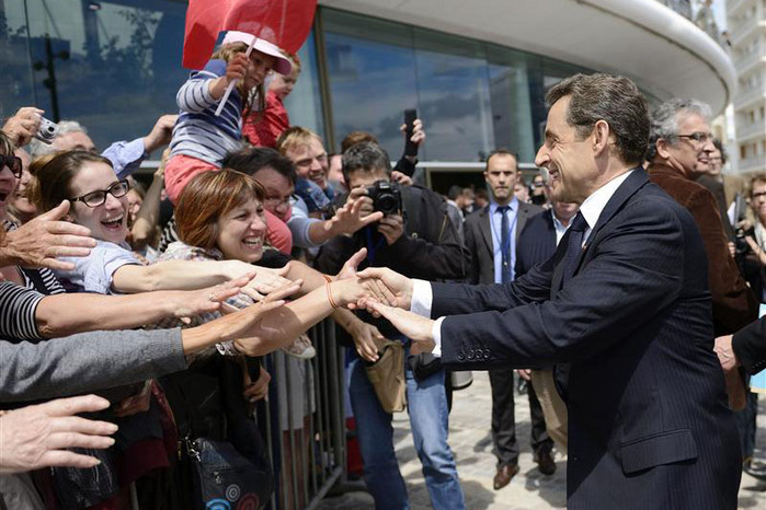 Nicolas Sarkozy on the campaign trail ahead of elections tomorrow  (Reuters)