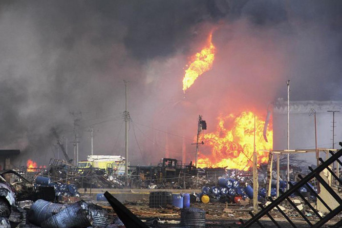 An oil container is seen in flames after the explosion  (Reuters)