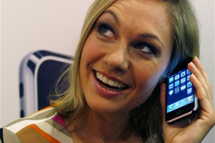 Model with the original iPhone (Reuters)