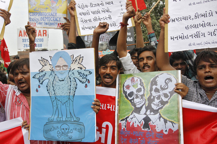 Communist Party of India-Marxist protestors hold a caricature of Indian Prime Minister Manmohan Singh (Reuters)