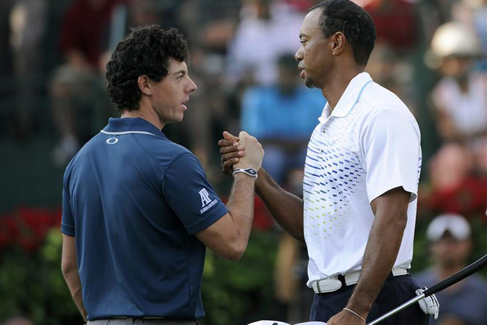 McIlroy and Woods congratulate each other on the 18th hole (Reuters)