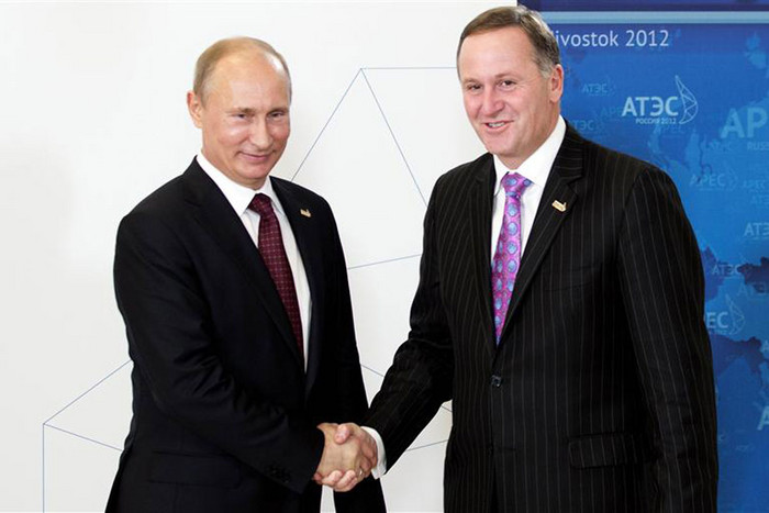 Prime Minister John Key shakes hands with Russian President Putin during the arrival ceremony for the Asia-Pacific Economic Cooperation Summit in Vladivostok (Reuters)