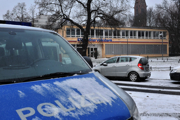 A police car stand in front of a bank building in Berlin, Germany (AAP)