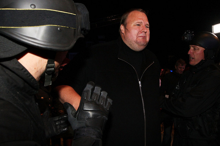 Kim Dotcom fools around with a fake swat team as he launches his new file-sharing site, Mega (Getty)