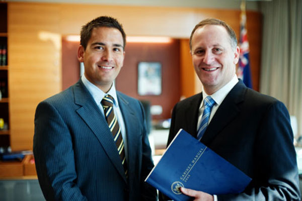 New Labour Minister Simon Bridges (L) and Prime Minister John Key
