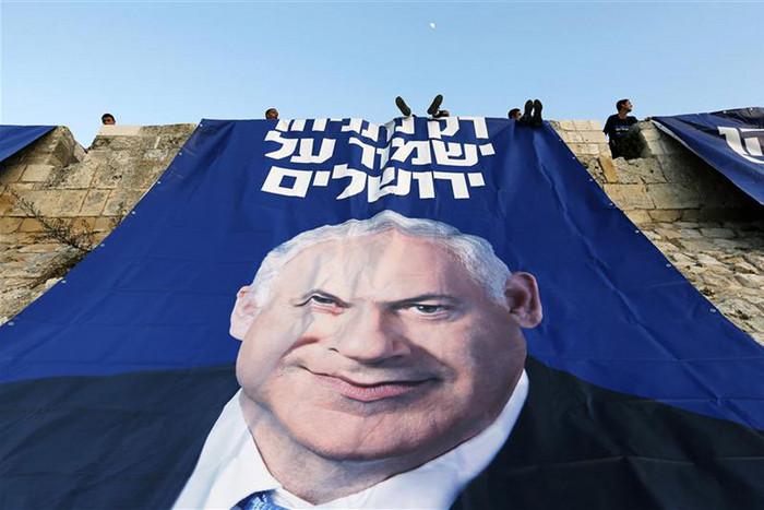 a campaign banner depicting Israel's Prime Minister Benjamin Netanyahu (Reuters)