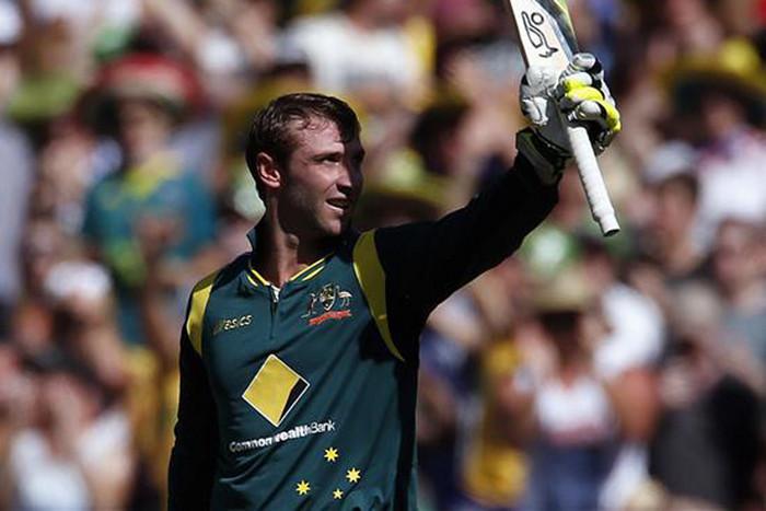 Australia's Phil Hughes celebrates reaching his century (Reuters)