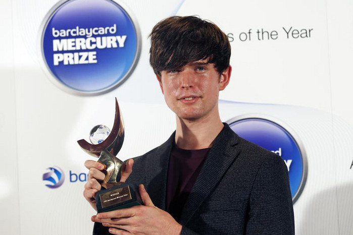 James Blake holds the 2013 Mercury Prize (Reuters)