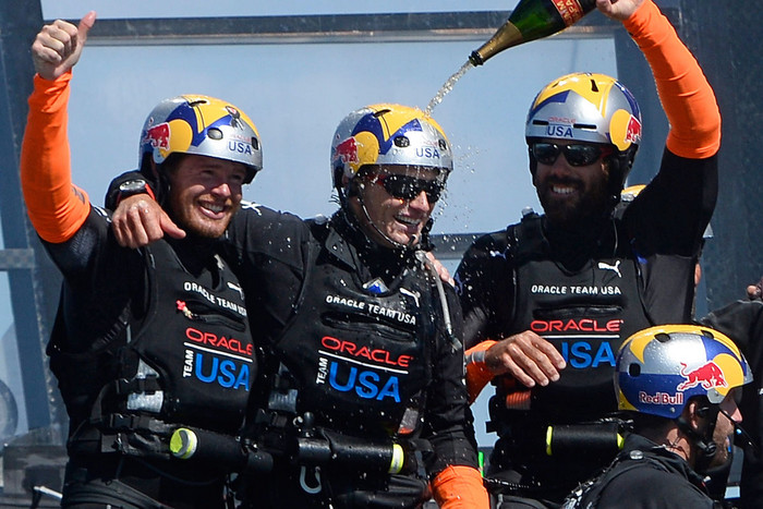 Oracle Team USA's Cup winning strategist Tom Slingsby, left (AAP)