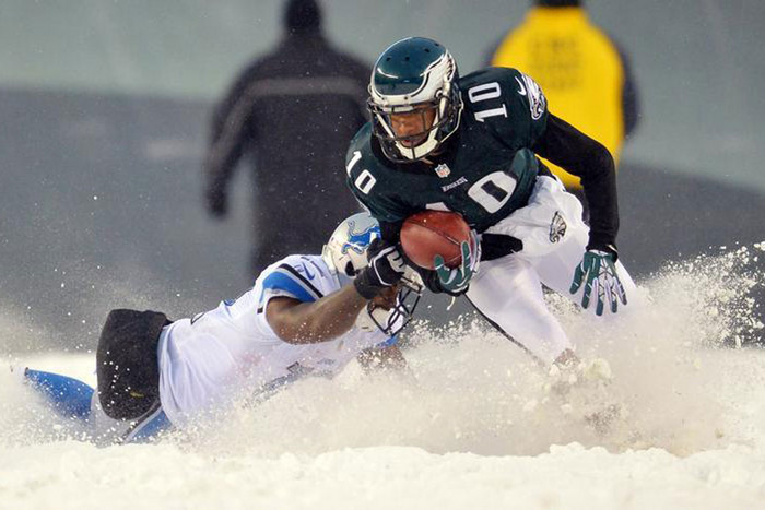 DeSean Jackson escapes a tackle in the snow (Reuters)