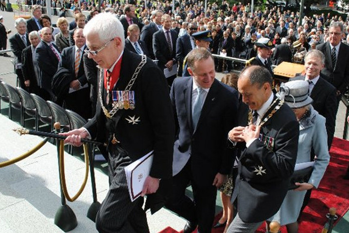 New Zealand Herald of Arms Extraordinary Phillip O'Shea leads Governor-General Lt Gen Rt Hon Sir Jerry Mateparae and Prime Minister Rt Hon John Key up Parliament's steps (Wikimedia Commons)
