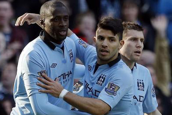 Manchester City's Yaya Toure, left, with Sergio Aguero... talent that hasen't quite reached the heights of last season but ready to explode (Reuters file)