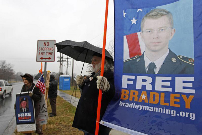 Supporters of US Army Pfc. Bradley Manning protest during his scheduled motion hearing (Reuters)