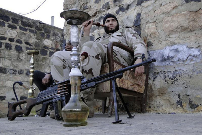 DATE IMPORTED: January 28, 2013 Free Syrian Army fighters smoke waterpipes near the Menagh military airport (Reuters)