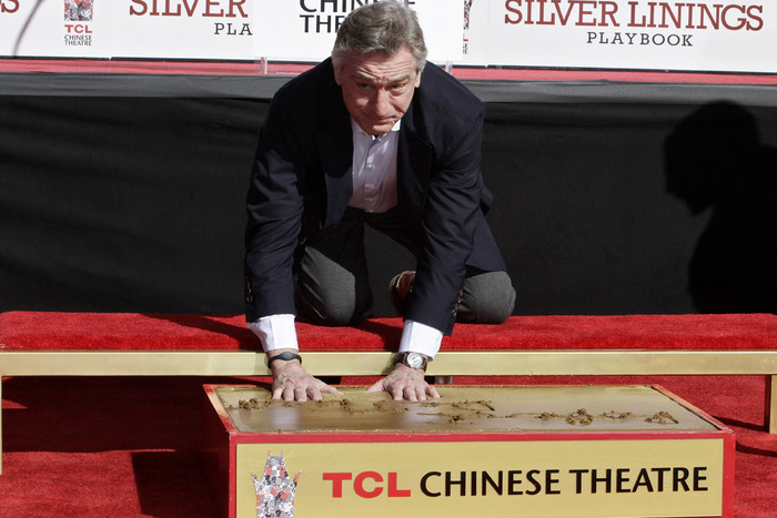 Robert De Niro leaving his mark at the TCL Chinese Theatre in Hollywood (Reuters)