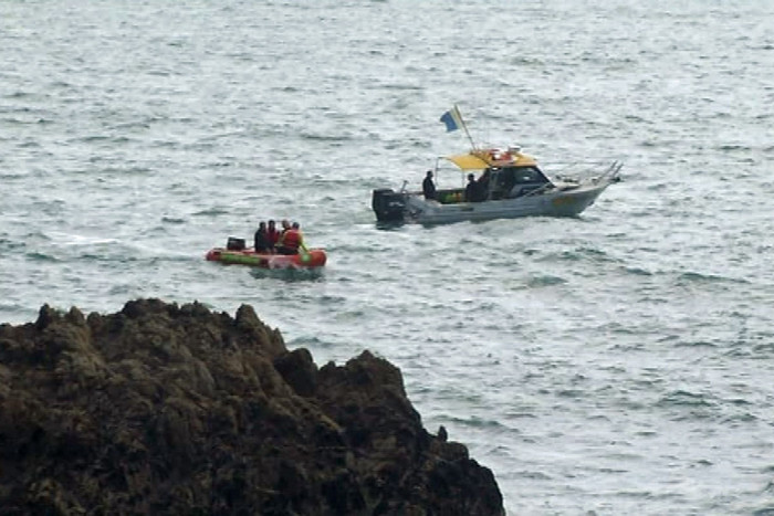 Instructor Bryce Jourdain, 42, jumped into the sea in an attempt to rescue the teens, but all three died