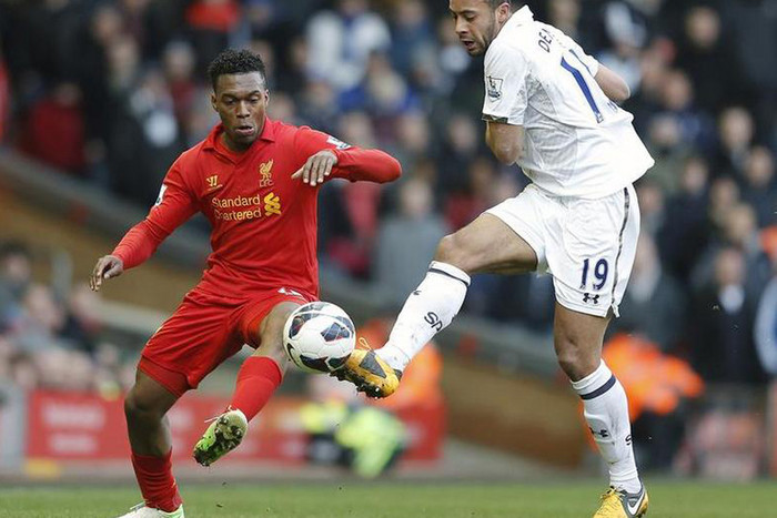 Liverpool's Daniel Sturridge (L) challenges Tottenham Hotspur's Mousa Dembele during their English Premier League soccer match at Anfield (Reuters)