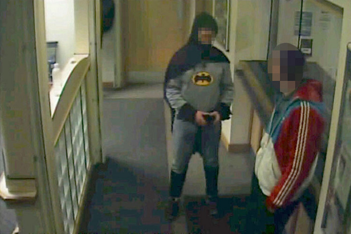 Police CCTV  footage showed a man dressed as Batman and a burglary suspect in a police station in Bradford, northern England (Reuters)