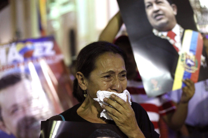 A supporter of Venezuelan president Hugo Chavez at Bolivar Square in Caracas after news of his death (AAP)