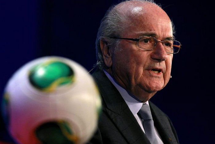 FIFA President Sepp Blatter says safety measures for the World Cup will include a security perimeter  around stadiums and a satellite will provide surveillance over the country (Reuters)