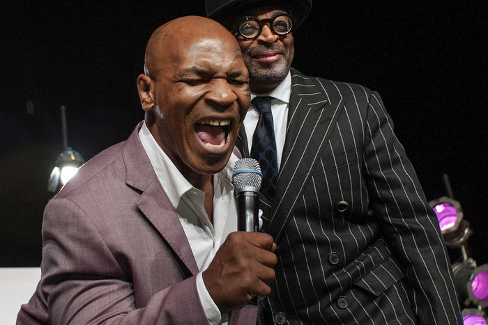 Film director Spike Lee (R) watches as former heavyweight champion Mike Tyson sings (Reuters)