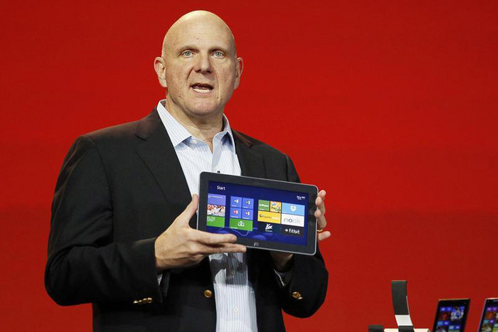 Microsoft CEO Steve Ballmer displays a Windows tablet (Reuters)