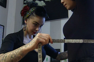 Ivy D'Auton measures Natasha Hing up for a new corset