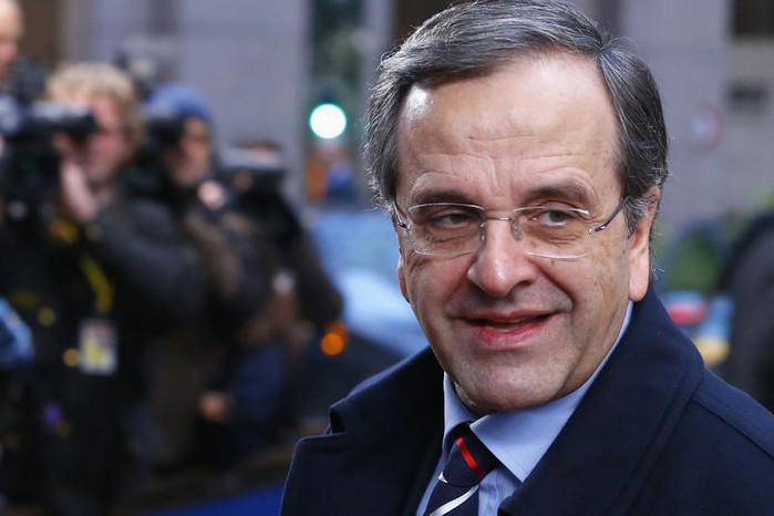 Greece's Prime Minister Antonis Samaras arrives at a European Union leaders summit at the EU council headquarters in Brussels (Reuters)