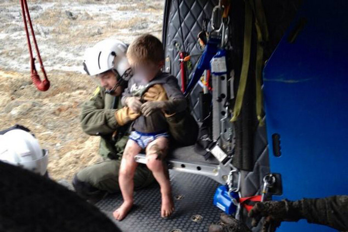 Rescuers pulled this four-year-old from the mud on Saturday (Photo: Snohomish County Helicopter Rescue)