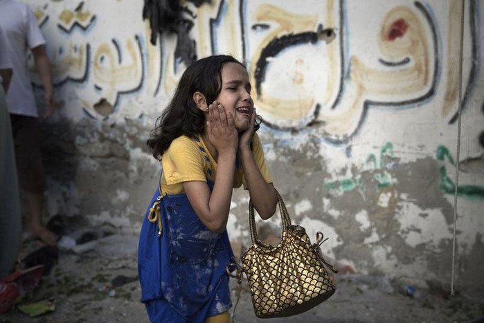 A Palestinian girl at the scene of an explosion in Gaza City (Reuters)