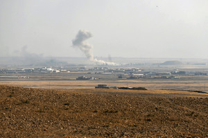 Smoke rises from clashes at Bartila in the east of Mosul during clashes with Islamic State militants (Reuters)